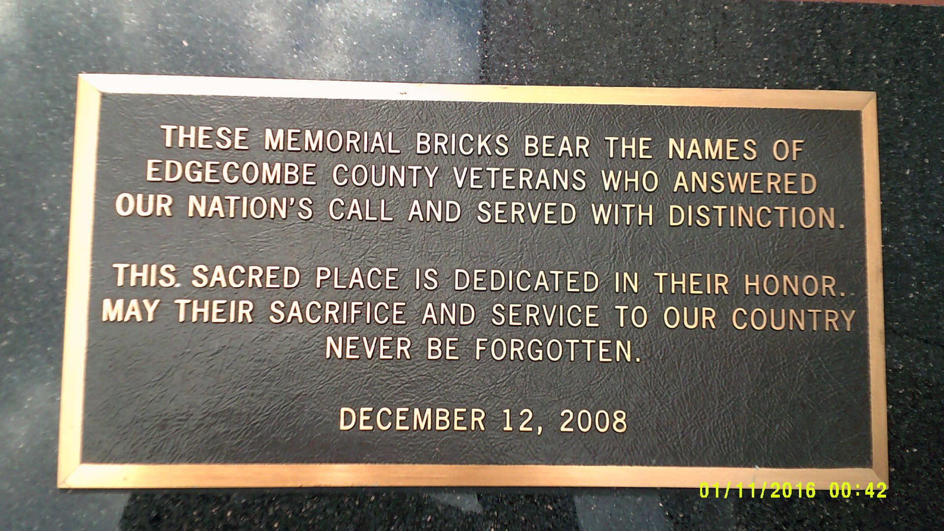 The plaque at the edge of the Memorial Bricks.