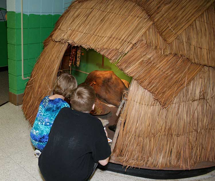 Children check out the Native American wigwam.
