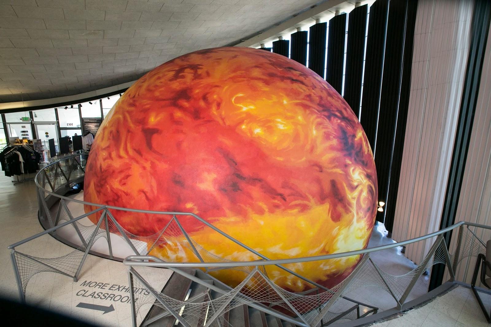 Muralist Erik Burke painted this large dome to look like the Sun. Credit: http://eriktburke.com/Planetarium