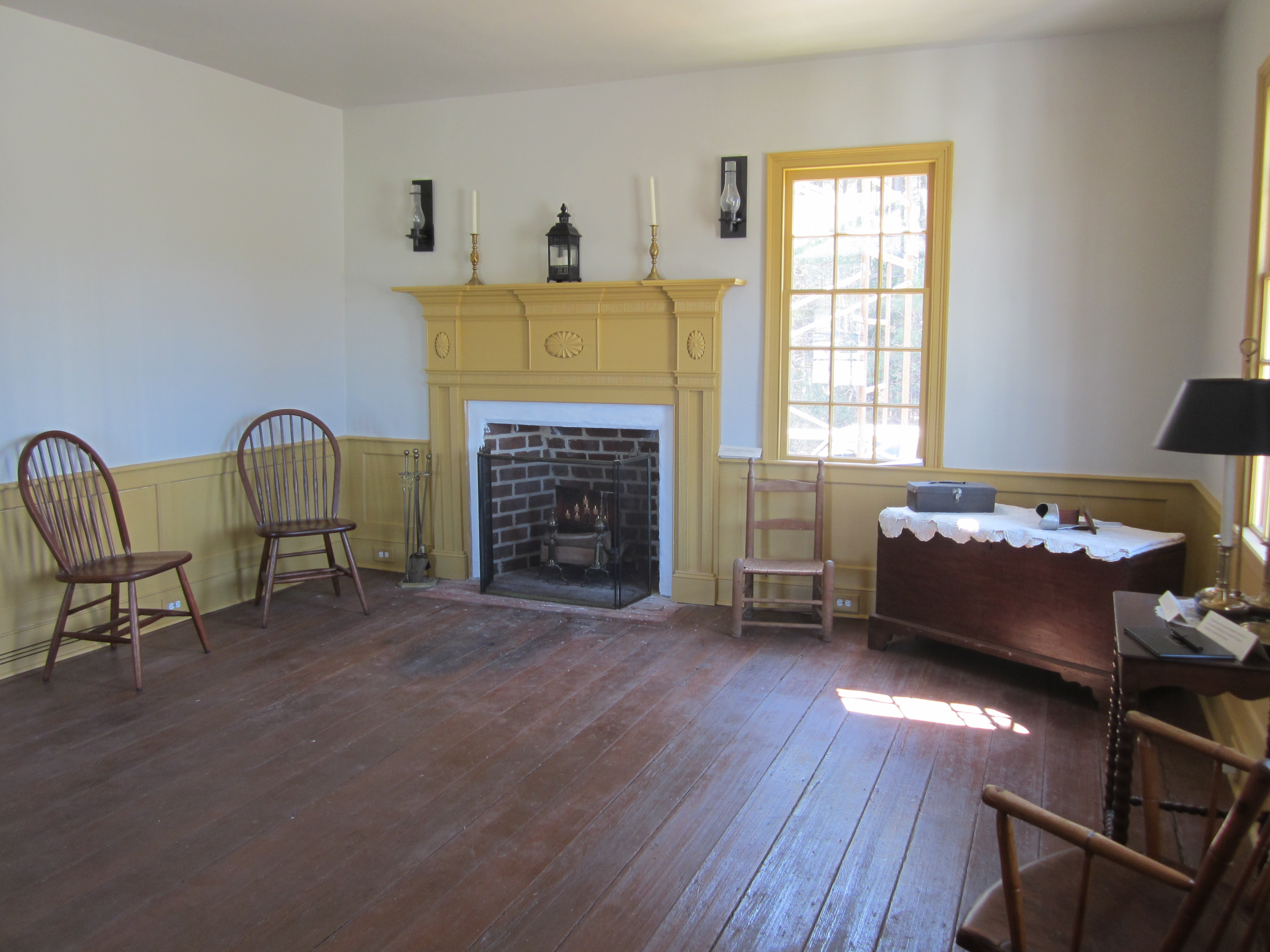 The original parlor of the house has been restored with museum era furnishings. The mantle, the windows and the wainscoting were all constructed by students to replace the missing items.