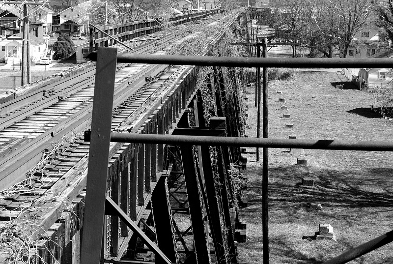 This photo shows the old concrete pylons that supported the single lane addition to the bridge that allowed for automobile traffic to cross Kanawha River.