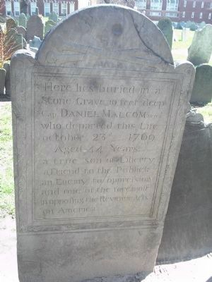 Gravestone of Captain Daniel Malcom, allegedly used for target practice by British soldiers (image from Historic Markers Database)