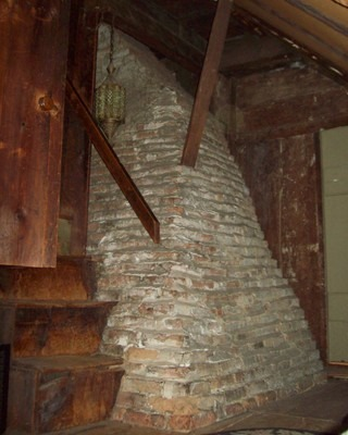 Garret stairs and chimney (image from Historic New England)