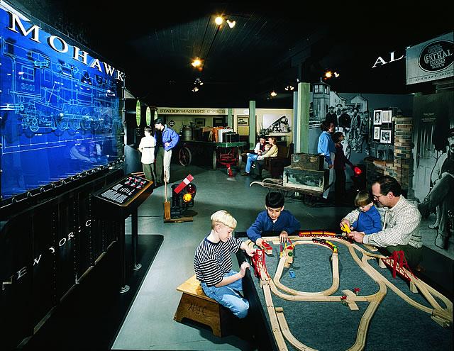 Children interacting with an indoor display.