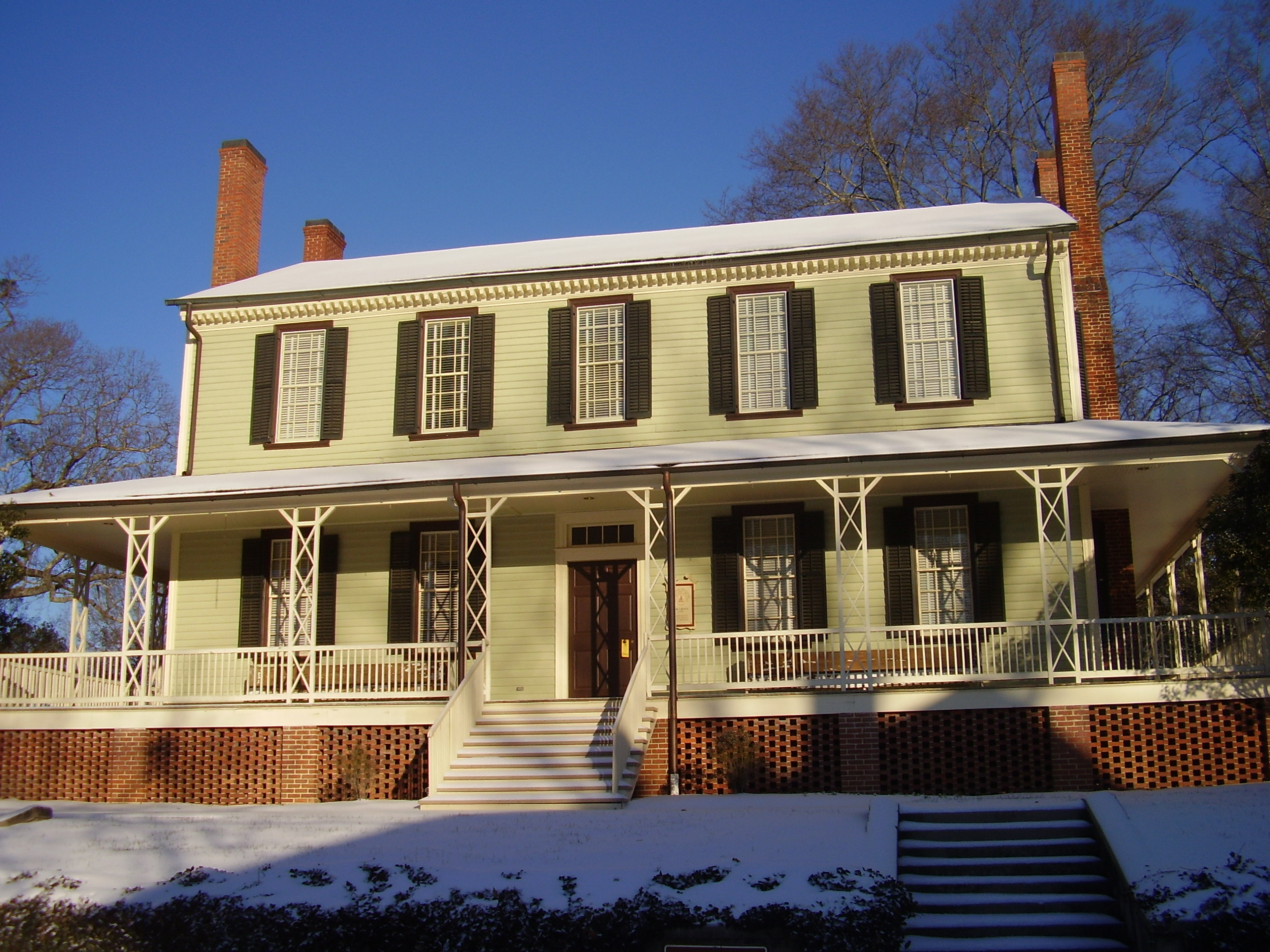 Front side of the house. Showing the 1850s addition porch (Photo taken in 2010).