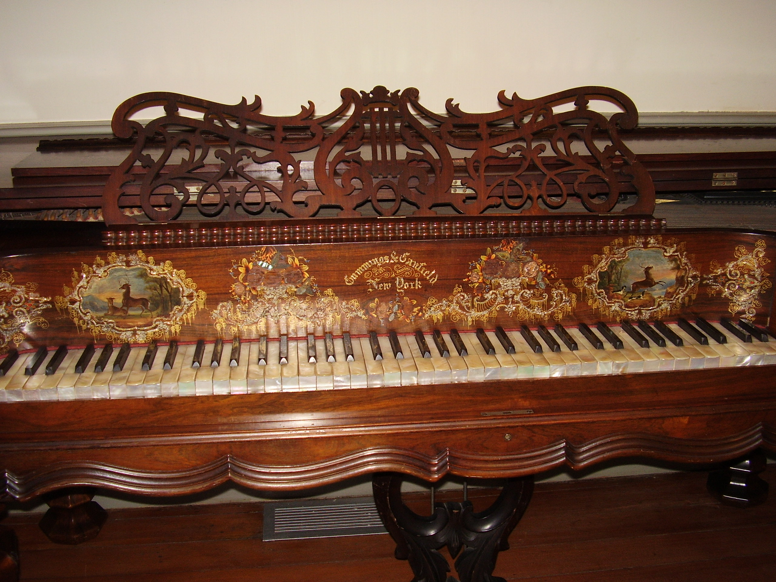 Cumming & Canfield piano ca 1855. Donated to the house by Alice Weeks Patrick. It has mother of pearl keys & gold leaf & mother of pearl inlay. It is one of only 5 such pianos known to exist.