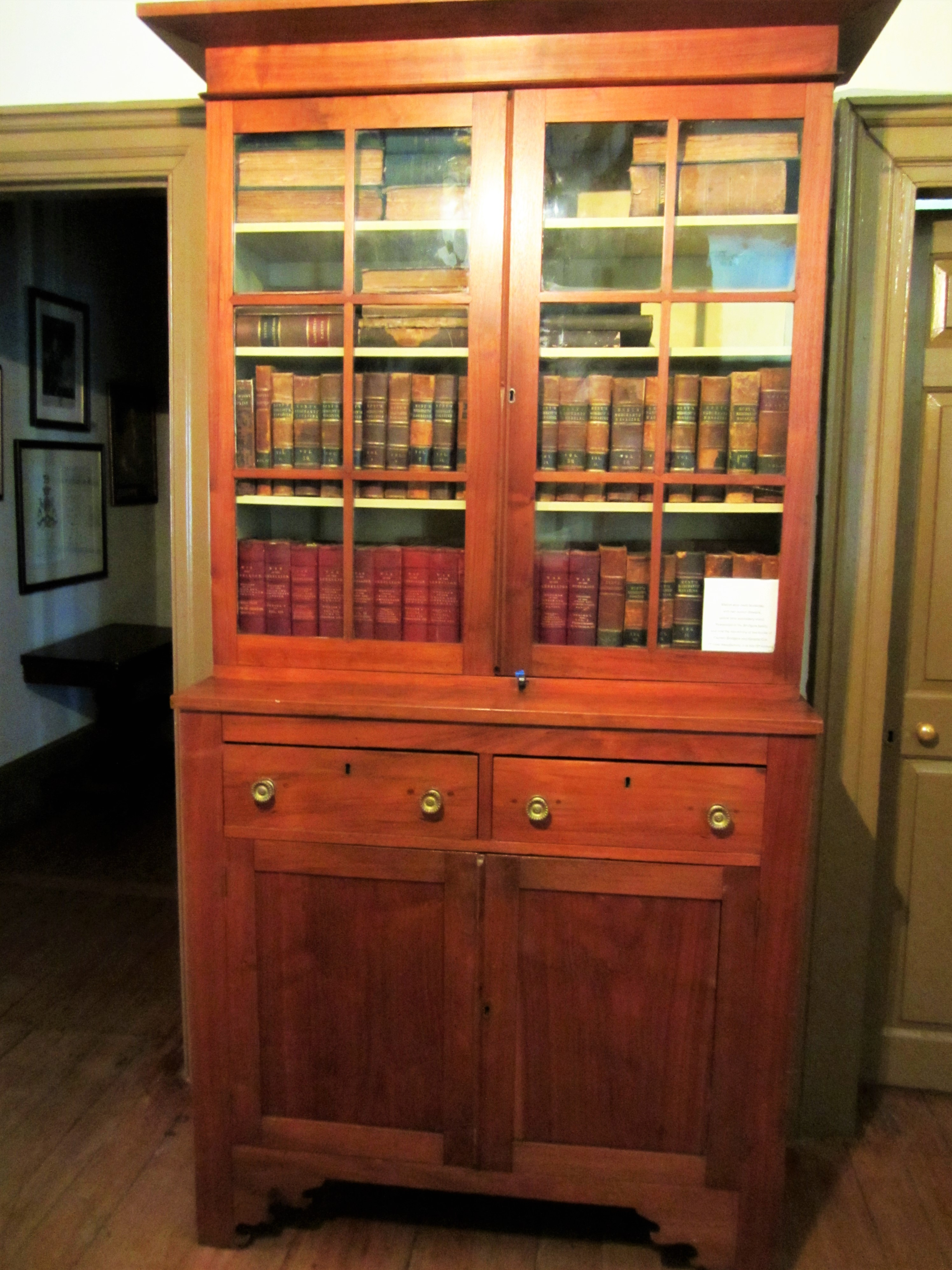 The Bridgers bookcase originally belonged to the Bridgers family & holds a collection of books belonging to the Bridgers & CSA officer William R. Cox.