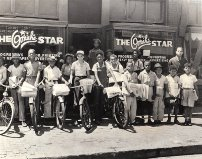 Local kids stand in front of The Omaha Star with stacks of newspapers. It was a major privilege to have your name printed in the paper during the Civil Rights Era because most of the media only portrayed Blacks in negative ways.