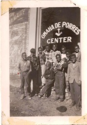 Here is a photo of members outside the DePorres center on 24th and Grace Street. This was the second location the DePorres club met at, they left later due to inability to pay rent and moved to another location.