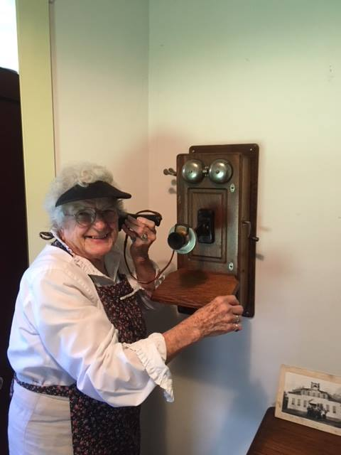 Fran Peters, docent, on a call in the Old Stevensville Post Office