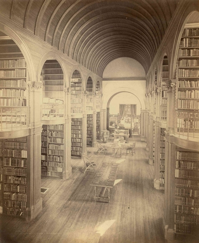 "This photo can be found in the ""Library History"" page at http://woburnpubliclibrary.org/about/library-history/. This photo shows the Romanesque arches inside the main reading room that H.H. Richardson designed."