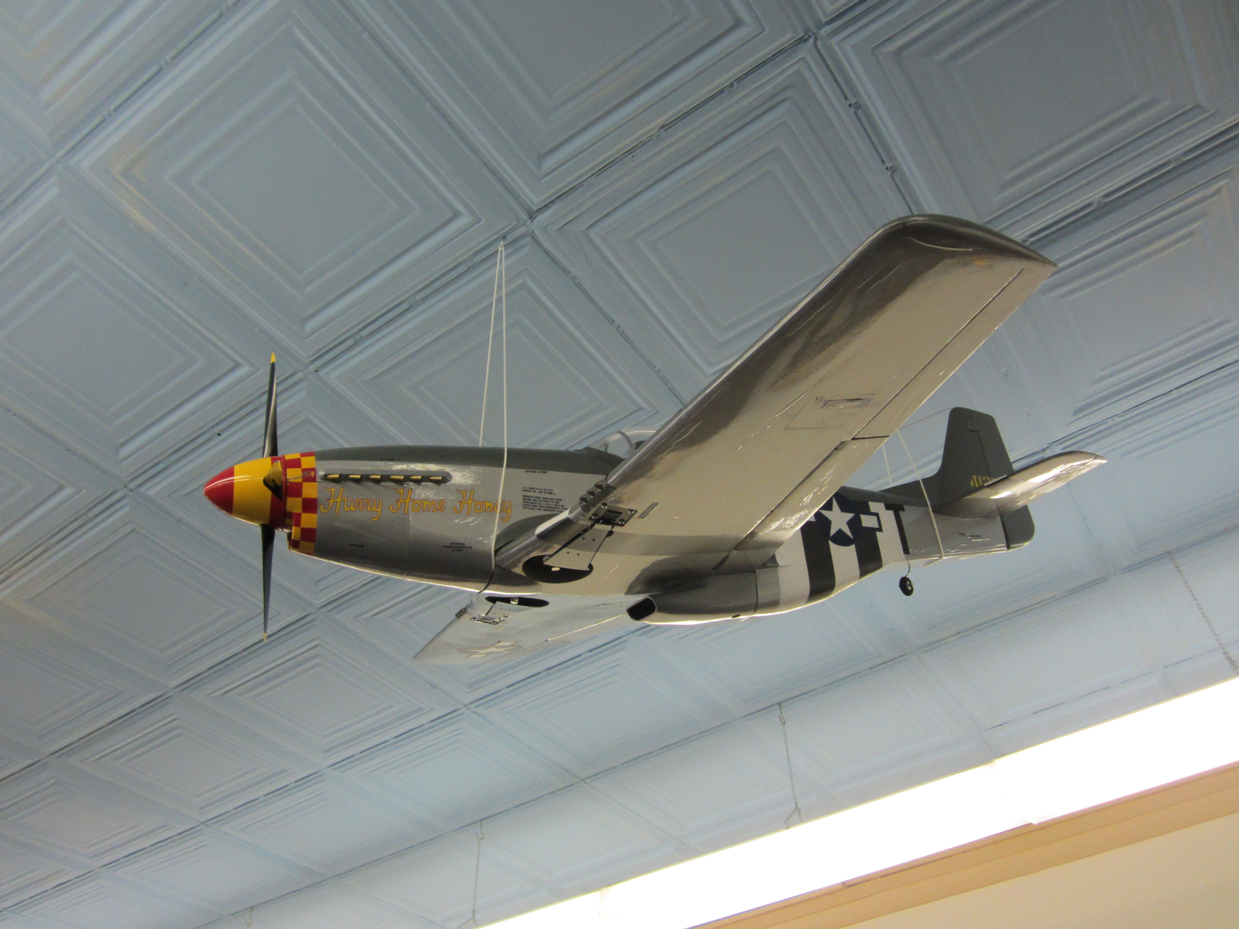 Radio controlled P-51 Mustang model airplane.