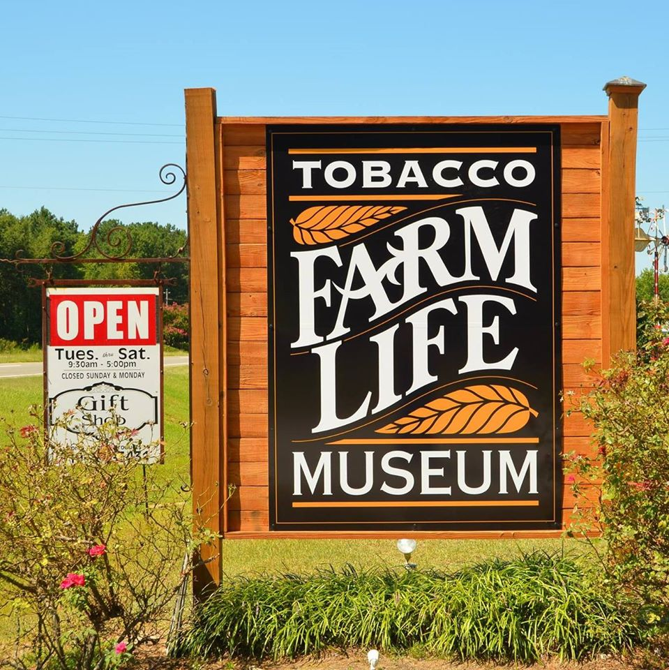 Tobacco Farm Life Museum sign located at the edge of the highway.