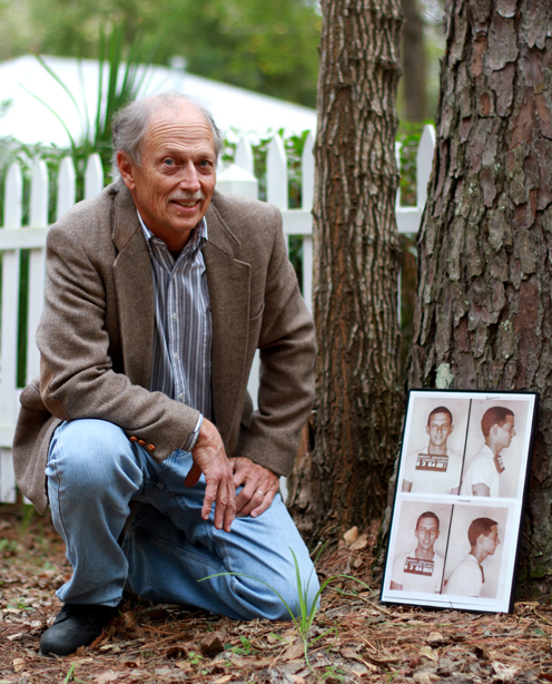Former student Dan Harmeling poses with his mugshots following his arrest for civil rights activism in Gainesville. Dan was one of the UF students who physical blocked the entrance to the theater in protest of racial segregation.