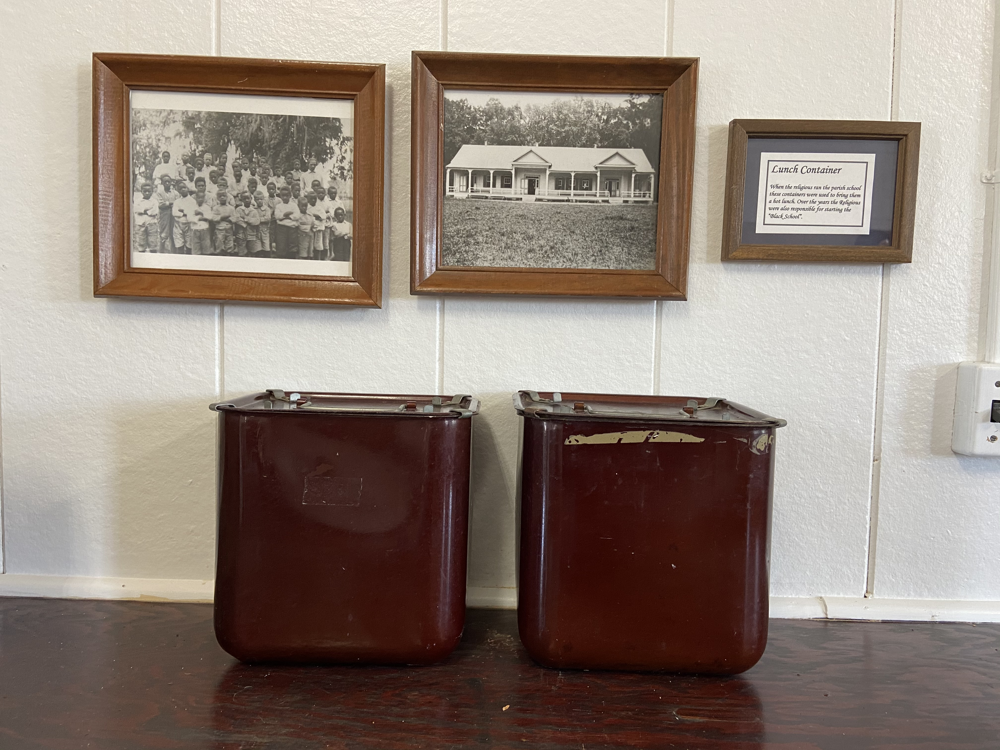 When the Religious of the Sacred Heart operated the parish school as well as the African American school in Grand Coteau, they traveled to and from the convent with their lunch in these containers.