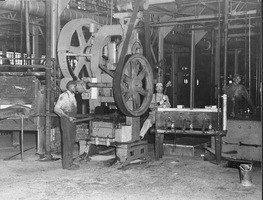 Workers on the job at the Kelly Axe and Tool Company in the early 20th century.