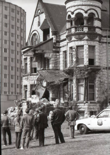 People look at the demolition of the Elizabeth Plankinton mansion circa October 1980