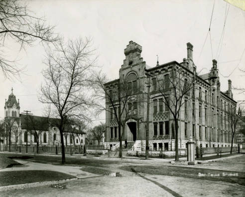 Marquette College with Holy Name Church circa 1900