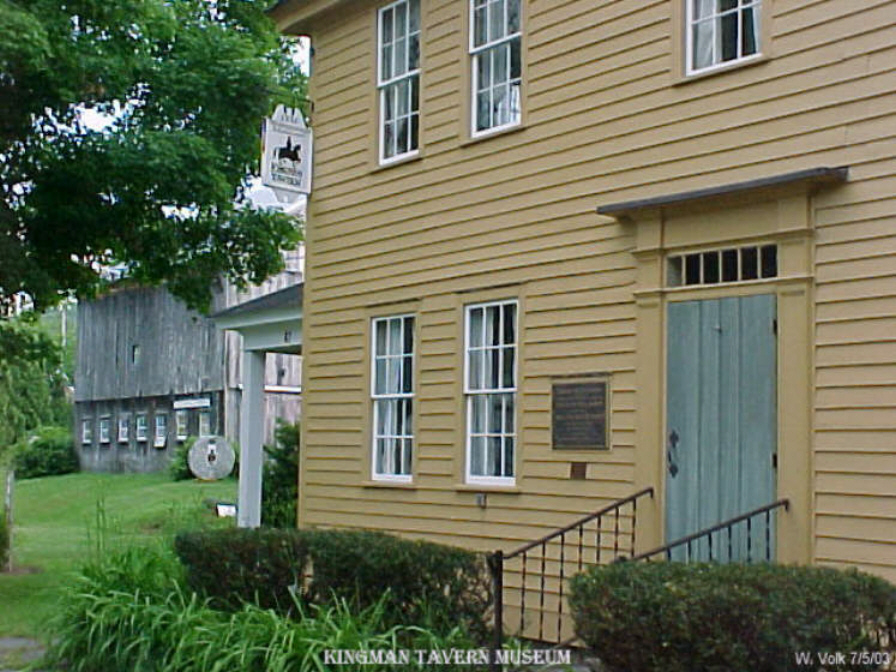 The Kingman Tavern Museum with barn in the background.
