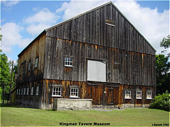 The historic barn that displays numerous vintage tools and farm implements.