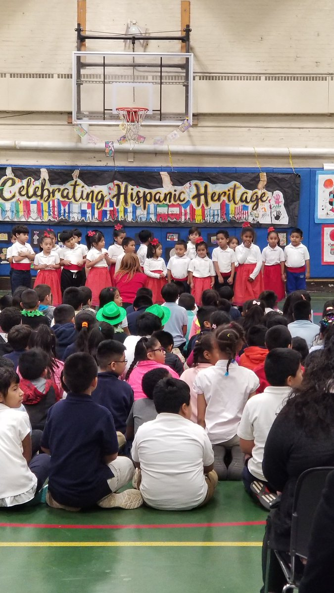 This is a photo of the student body and faculty inside their gymnasium during their annual Hispanic Heritage Celebration. Though it's a little cramped for over 600 students, they find ways to make the best of it.