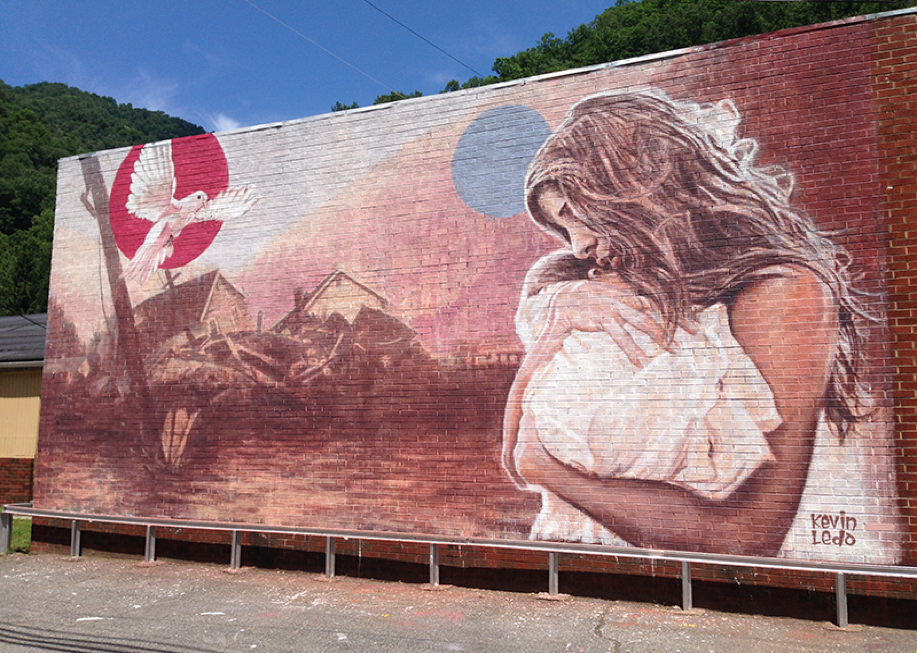 "The mural painted by Canadian Muralist, Kevin Ledo, titled ""Buffalo Creek Memorial Mural""