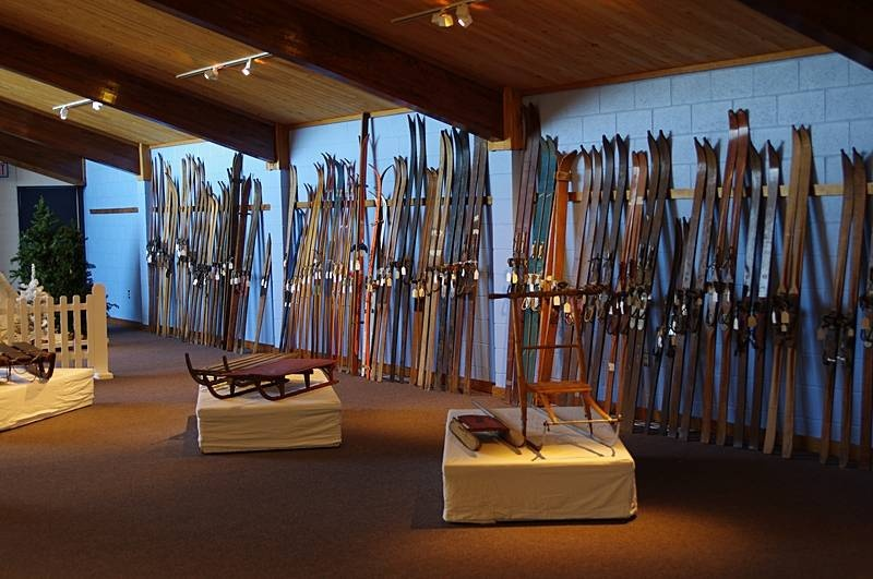 Several old skis and sleds on display