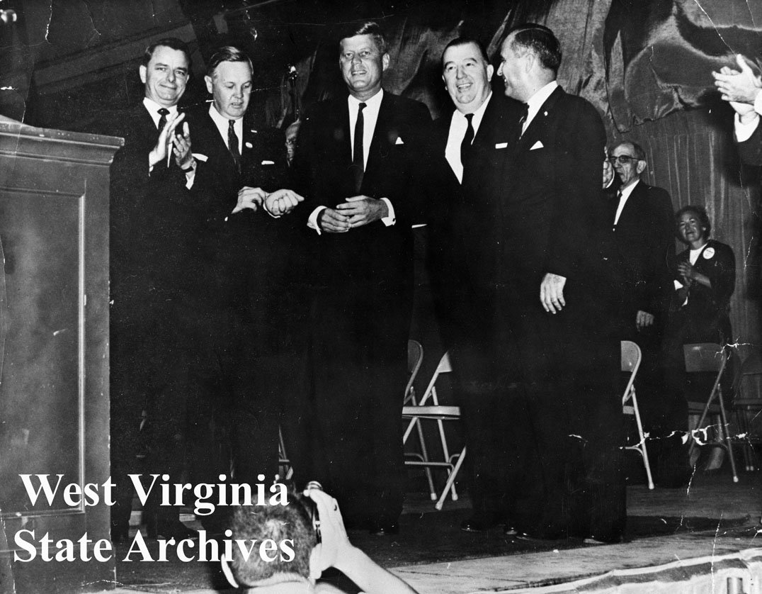L-R: Senator Robert C. Byrd, state Democratic chairman Hulett C. Smith, Senator John F. Kennedy, Senator Jennings Randolph, Democratic gubernatorial candidate W.W. Barron. 1960. Civic Center Collection, West Virginia State Archives.