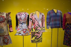 An image from The Valentine's website of some of clothing on display in an exhibition
