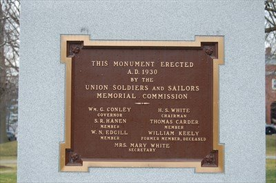 The plaque that states the date the memorial was erected and contains the names of the members of the Union Soldiers and Sailors Memorial Commission who erected it.