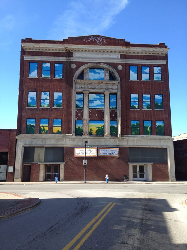 West Side Main Street installed plywood murals in 2013 that covered the windows.