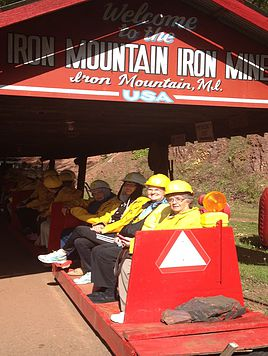 Visitors on the train entering the mine