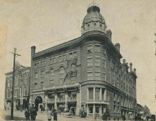 "Built in 1891 to replace the Arlington at corner #2, the Hotel Burton was elegant in its day. It even had a specialized ""ladies"" entrance, where females might enter and go up unseen to the Ladies Parlor on the mezzanine floor."