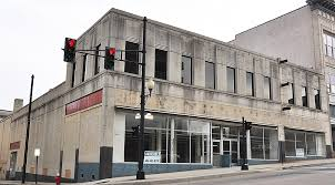 In the early 1930s, Danville architect J. Bryant Heard began to design in a somber monumental version of the Art Deco style. 501 Main Street--Woolworth's on corner #4--was designed by Mr. Heard in 1937 and built by R. E. Clarson.