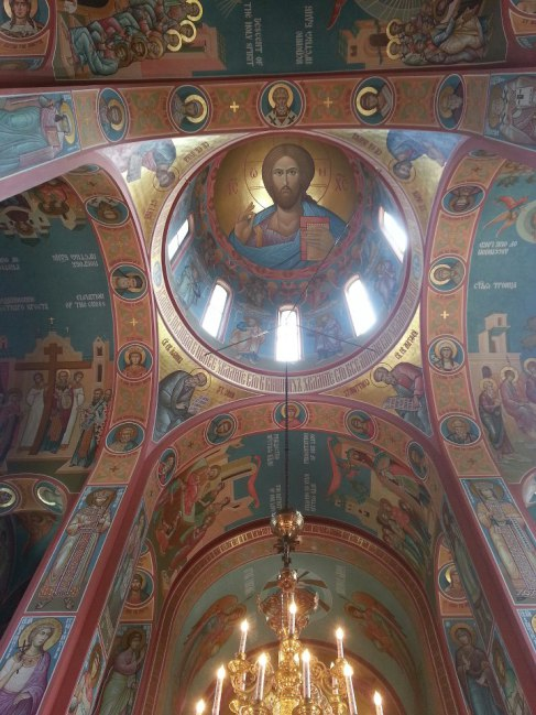 Interior dome with the image of Christos Pantokrator. The interior is full of elaborate and hand-painted icons related to the history and belief structure of the Eastern Orthodox Church.