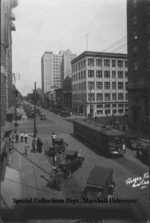 4th Ave between 10th St & 11th St, Huntington, with the Coal Exchange visible in the background, ca. 1920's