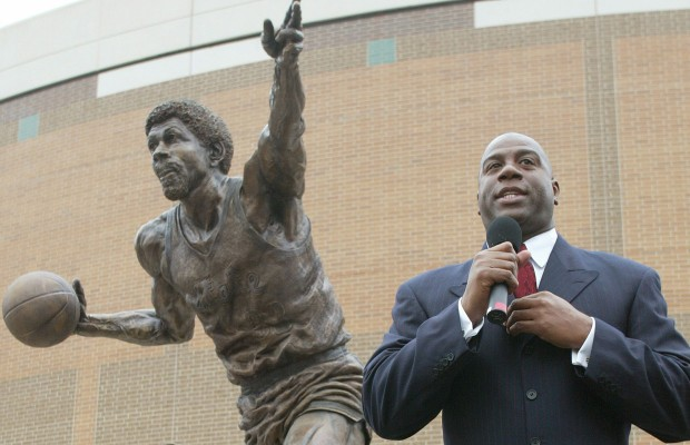 "Earvin ""Magic"" Johnson in front of the statue."