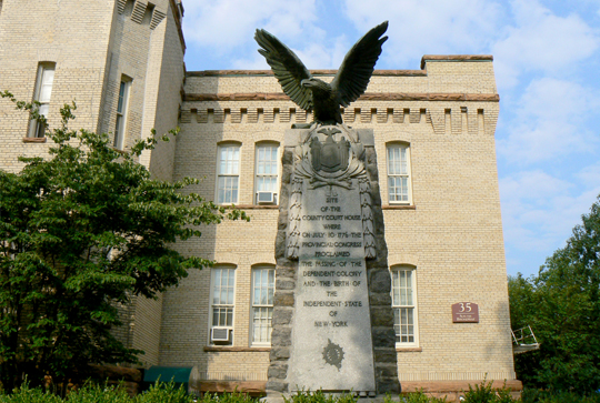 Photo of the Armory and monument with an eagle to commemorate the old courthouse.