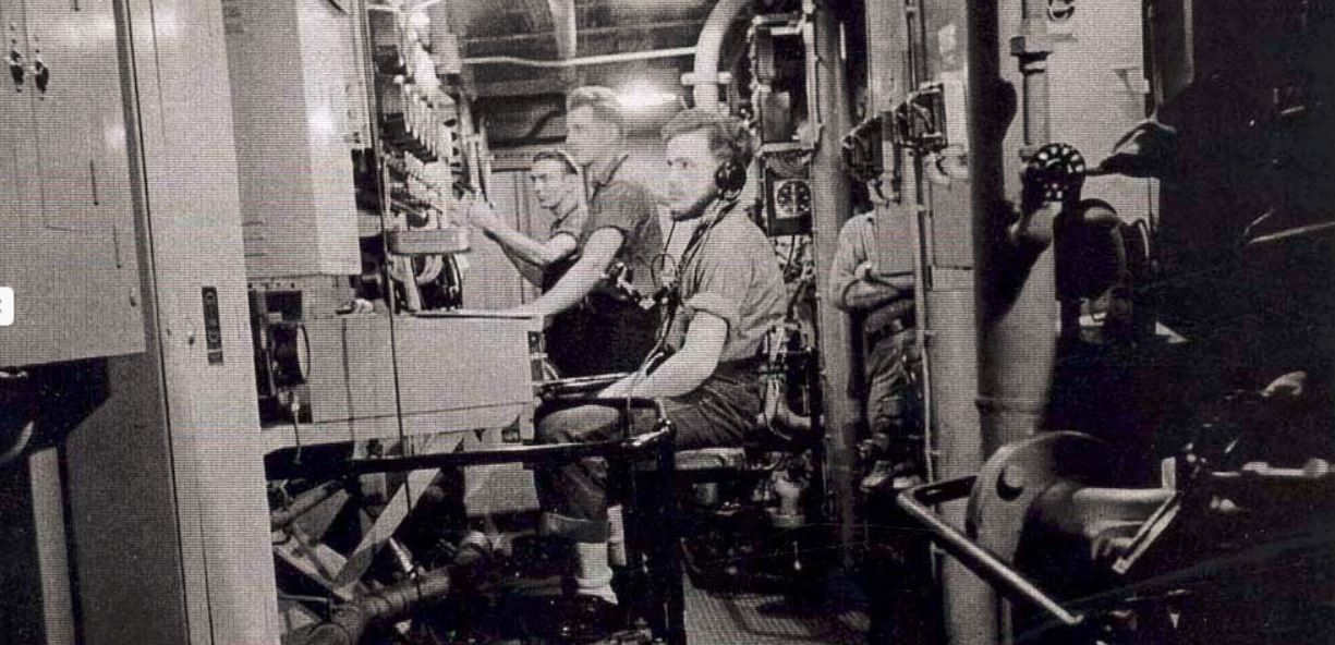 Men at work in the engine room