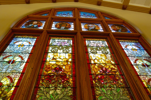 The stained glass windows in the main reading room, featuring Shakespeare, Goethe, Longfellow and Prescott