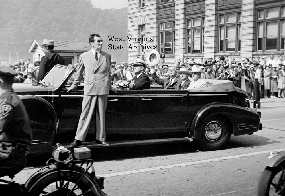 President Franklin D. Roosevelt in a parade car with Governor Homer Holt and Senator Matthew Neely on Kanawha Boulevard near the Union Building, Charleston, 3 September 1940. Photo: Malcolm R. Mathews Jr. Malcolm R. Mathews Jr. Collection, West Virginia S