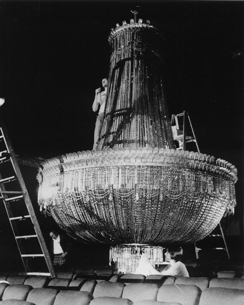 The Byrd's large chandelier lowered for cleaning.