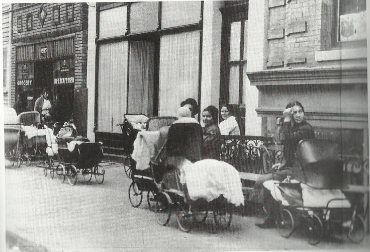 Mothers with carriages stand outside the Brownsville Clinic, Brooklyn