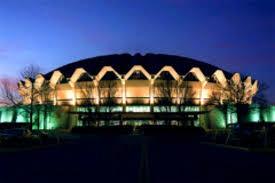 West Virginia University Coliseum at night.