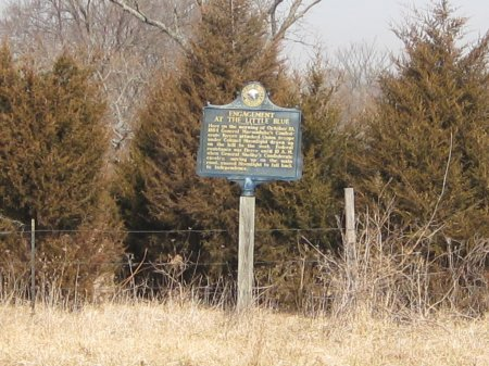 This marker is on the westbound side of the highway on the east side of the Little Blue River