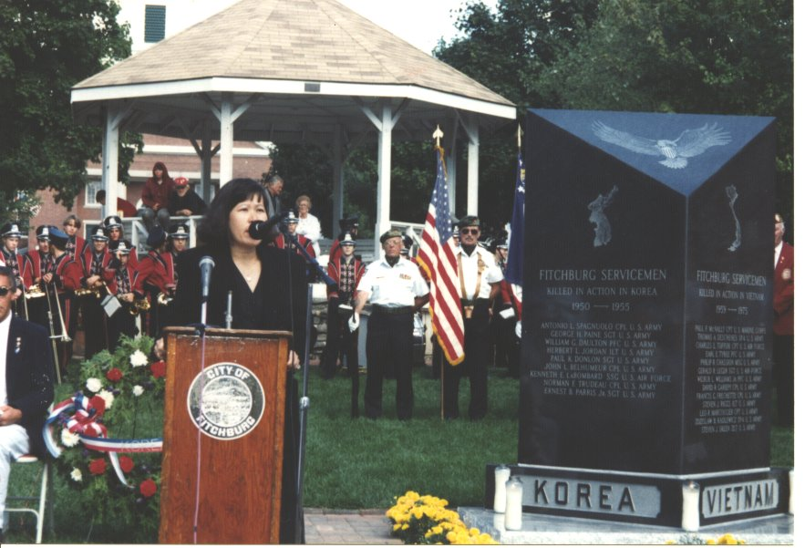 Mrs. Sam Yoon reading a poem to honor her brother, at Vietnam War memorial dedication