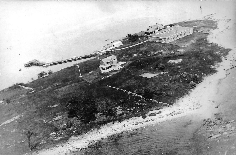 This photo of the island in the 1920s shows the hospital and doctor's house that were part of the immigration processing station.