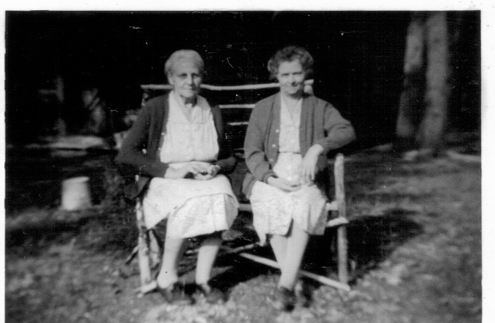Mrs. Ayda Niemoth (on left) and Mrs. Louise Winter (on right) in front of the Niemoth Cabin, circa 1934.