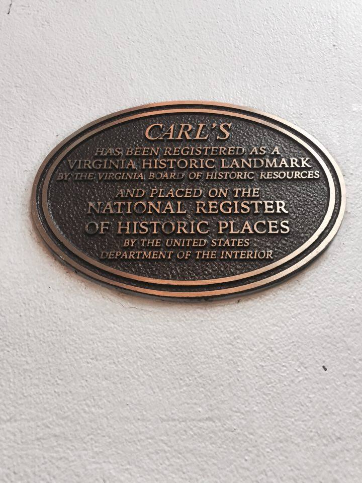 The Plaque on the wall of the building that designates Carl's as a part of the National Register of Historic Places.
