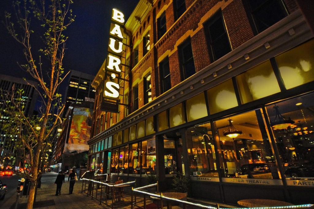 The restaurant and listening lounge with outdoor seating photographed at night.